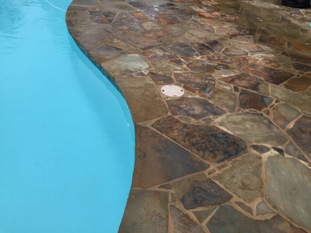 Stones around swimming pools add iron and copper to the water which stain the surfaces of your pool