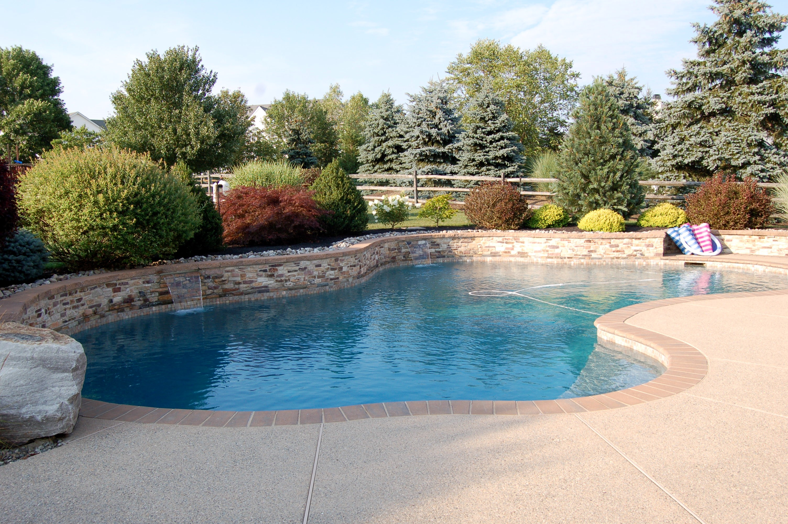 Stone Wall, Brick Coping, Large Rock, Fertilizer From Vegetation, All Add Metals To Swimming Pool Water And Cause Staining On Gunnite Surfaces