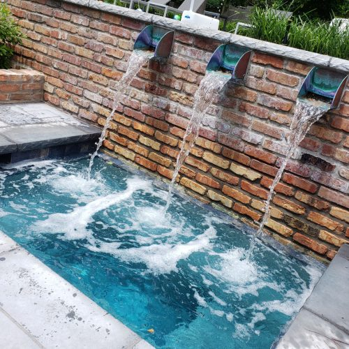 Copper spouts add copper to the water which causes staining and copper cyanurate. The bricks in this swimming pool add stain-causing iron to the water and can cause rust spots.